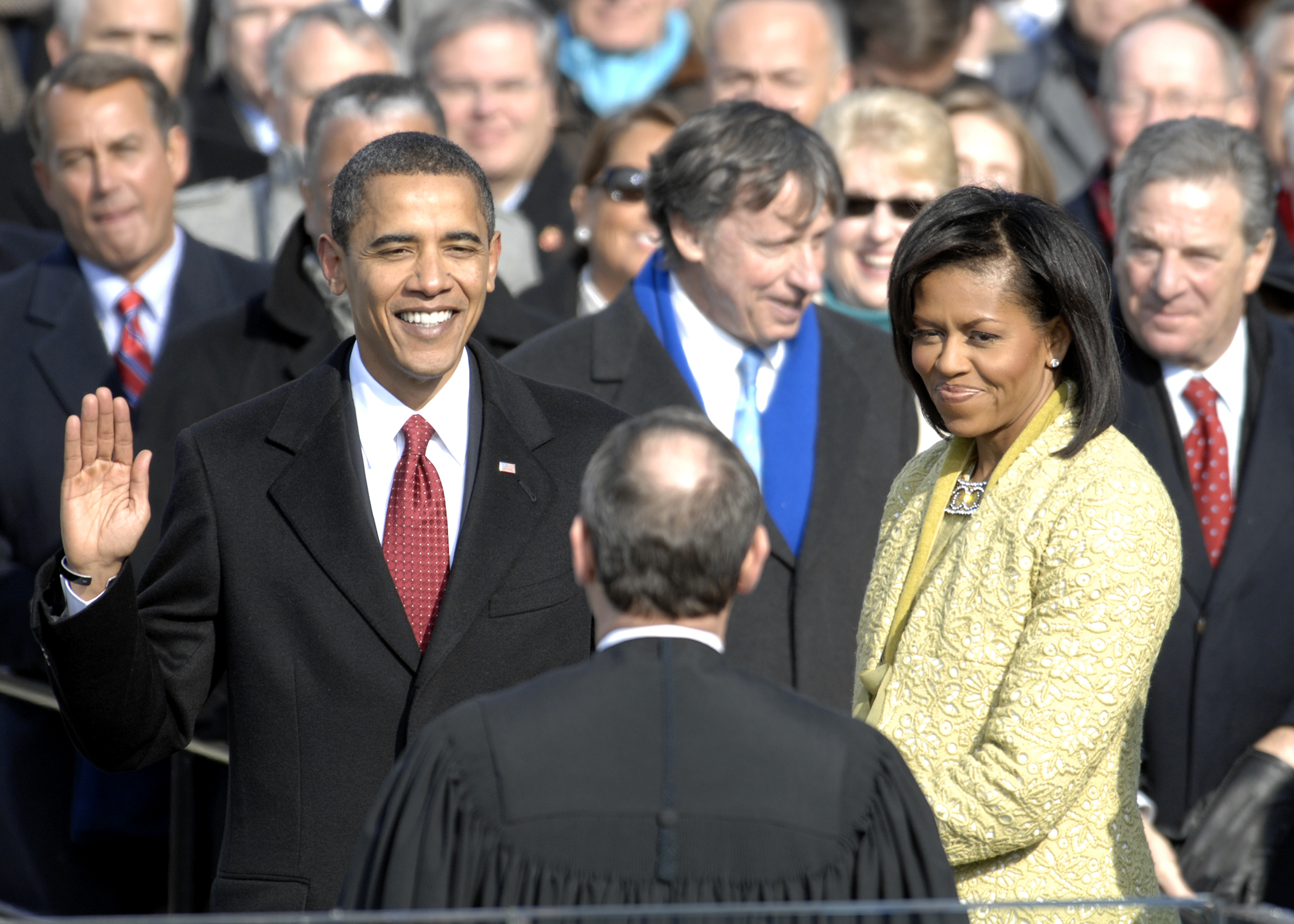 With his family by his side, Barack Obama is sworn in as the 44th president of the United States by Chief Justice of the United States John G. Roberts, Jr. in Washington, D.C., Jan. 20, 2009. More than 5,000 men and women in uniform are providing military ceremonial support to the presidential inauguration, a tradition dating back to George Washington's 1789 inauguration.  Permission details This image or file is a work of a U.S. Air Force Airman or employee, taken or made as part of that person's official duties. As a work of the U.S. federal government, the image or file is in the public domain in the United States.