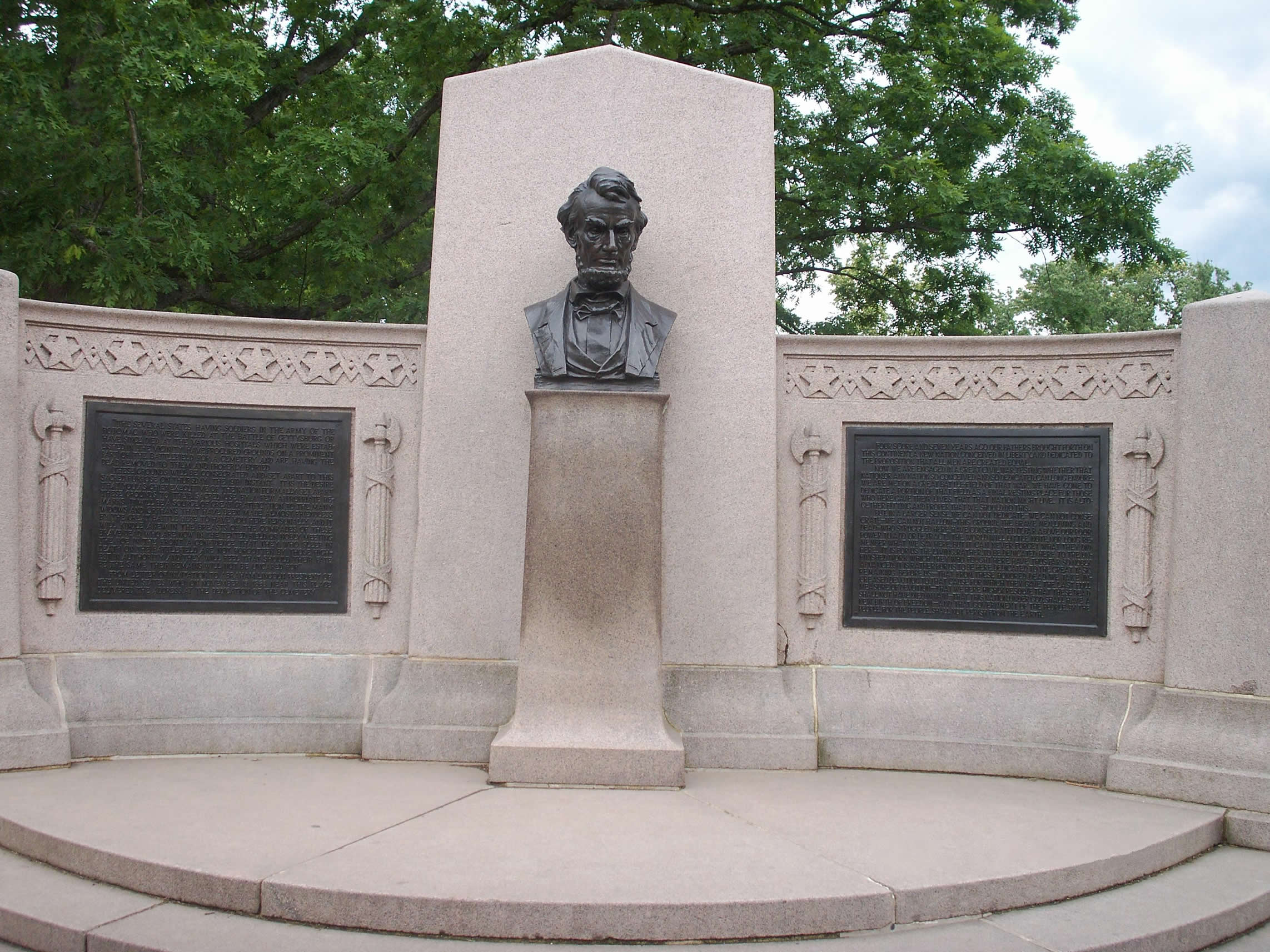 The Lincoln Address Memorial, designed by Louis Henrick, with bust of Abraham Lincoln by Henry Kirke Bush-Brown, erected at the Gettysburg National Cemetery in 1912.